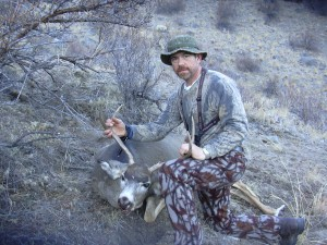 A god friend of mine Dean Cote with a nice mulie taken with a bow.