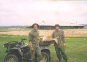 My first deer with a bow (me on the right).  This doe had now way of knowing that she would fuel my passion for bowhunting.
